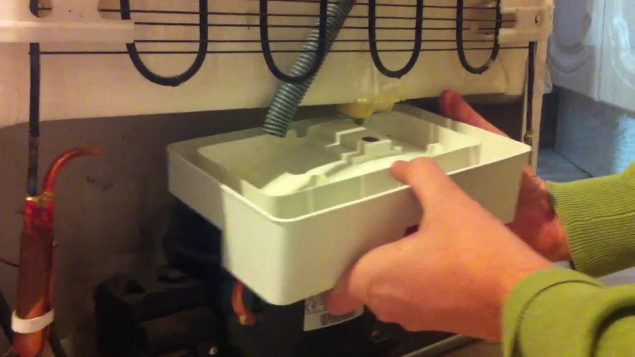 как слить воду с холодильника